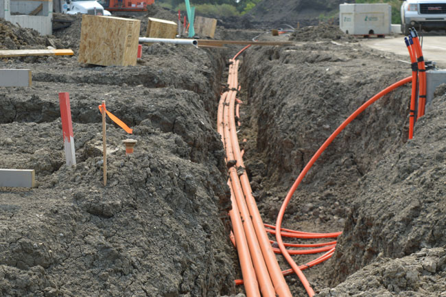 A trench dug for powerline installation by Superior Trenching Ltd. commercial trenching & excavation services