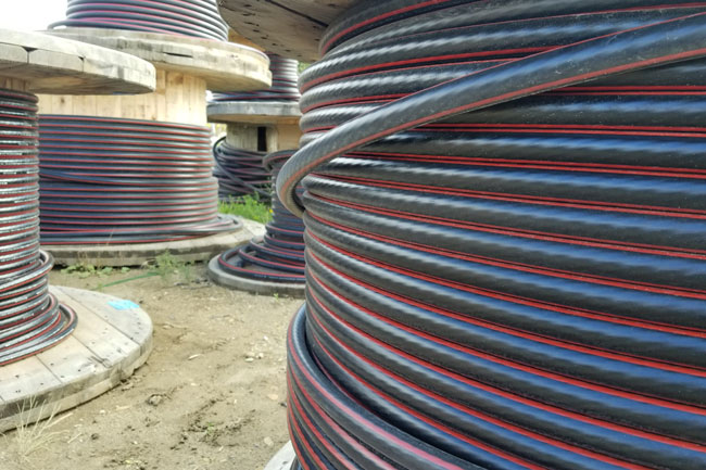 Spools of electrical wire used for Subdivision Underground Residential Development Services by Superior Trenching Ltd.