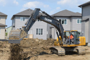 Basement excavation with a backhoe - careers in trenching & excavation with Superior Trenching LTD.